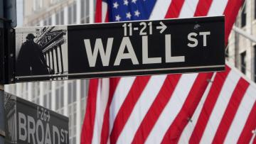 The Wall Street sign is pictured at the New York Stock exchange.