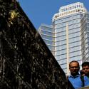 Office workers climb down a bridge in Mumbai's central financial district