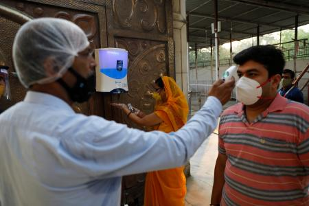 Sanitisers and thermal scanners are the new normal of visiting temples in times of coronavirus.