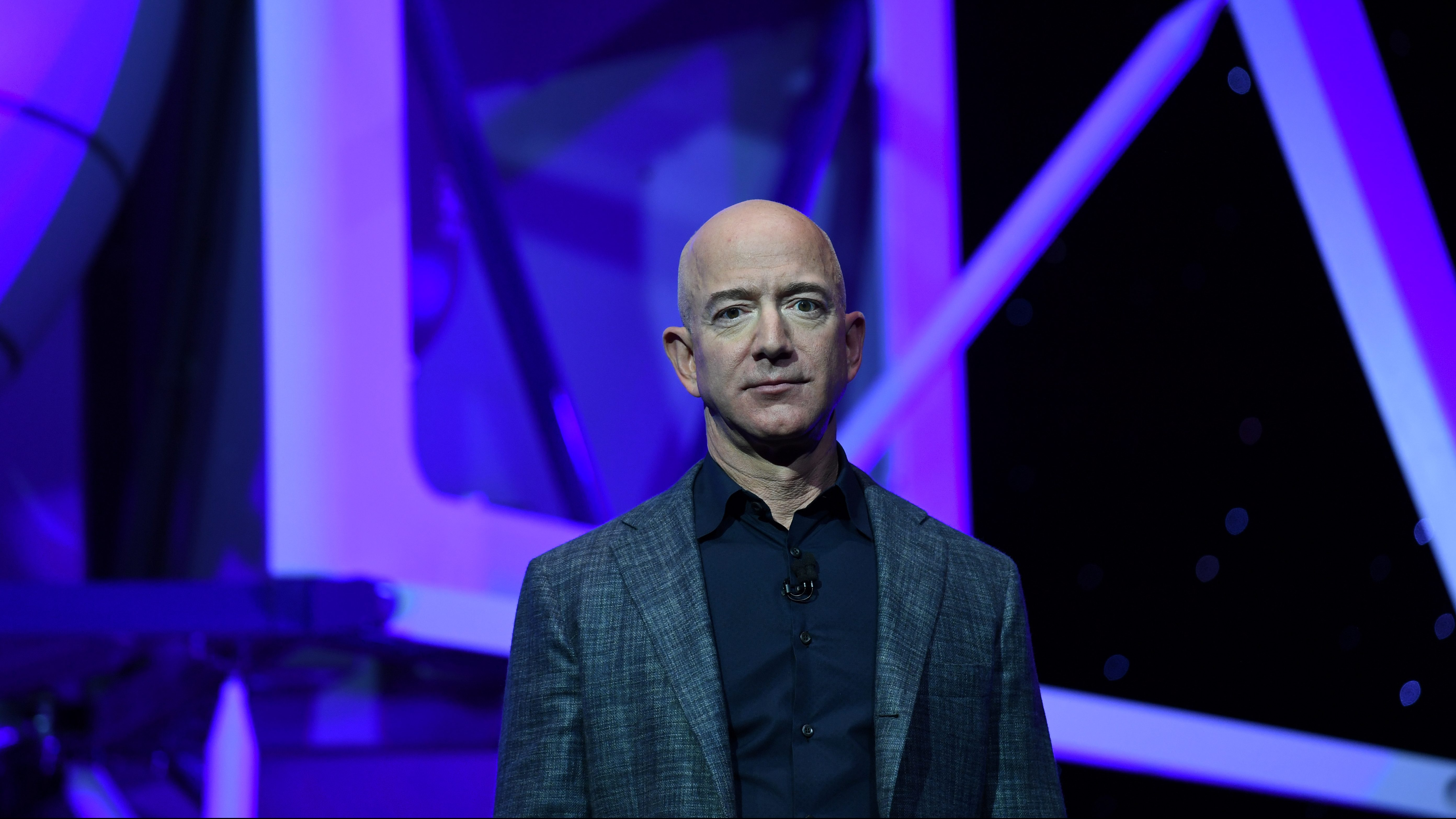 Amazon CEO Jeff Bezos looks a little blue while unveiling his new spaceship.