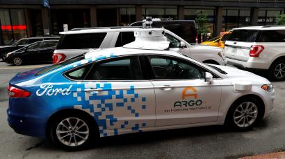An Argo Ai self driving prototype vehicle is seen outside a Ford and Volkswagen joint news conference in New York City.