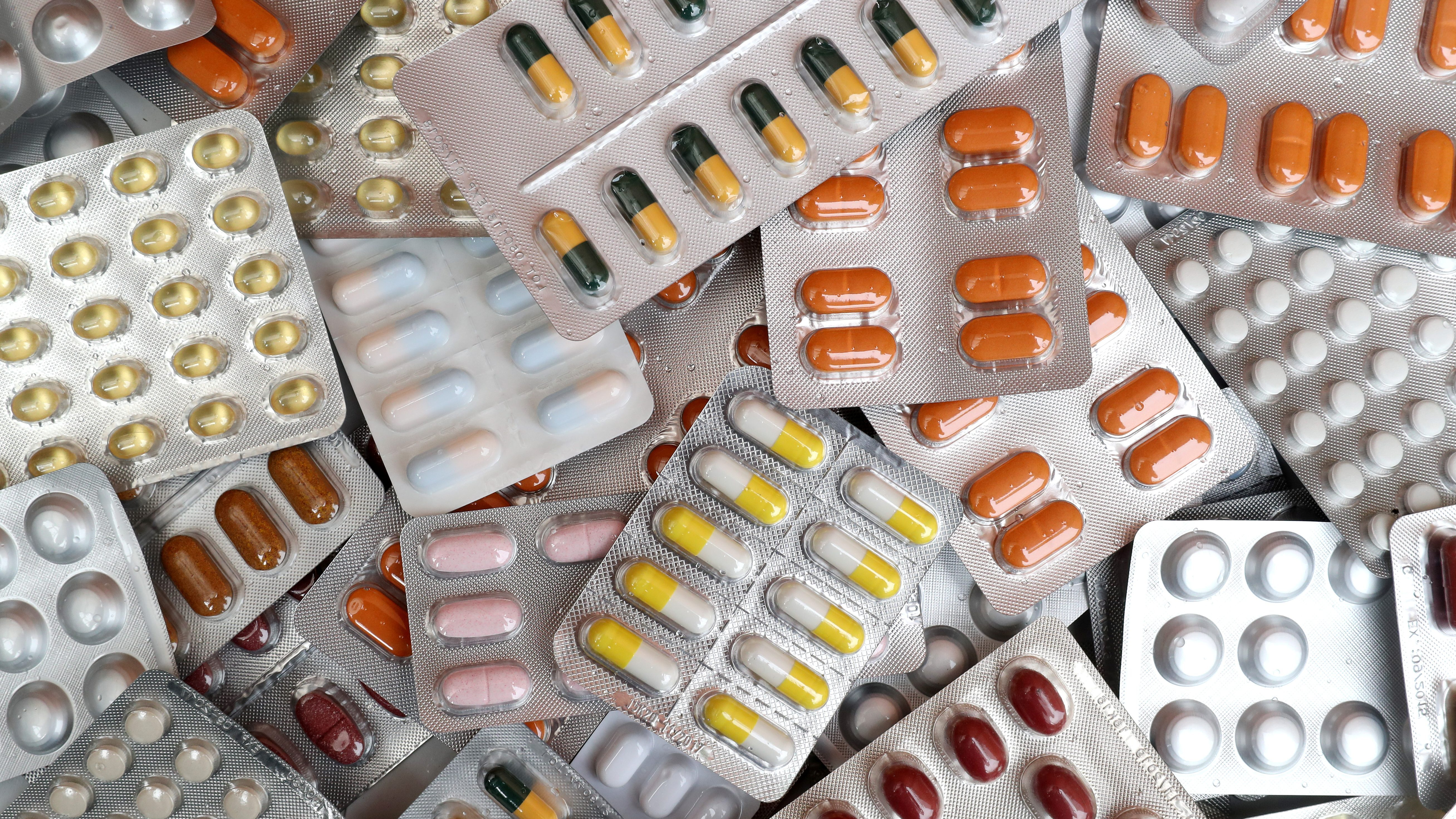 Various types of pills in plastic packaging