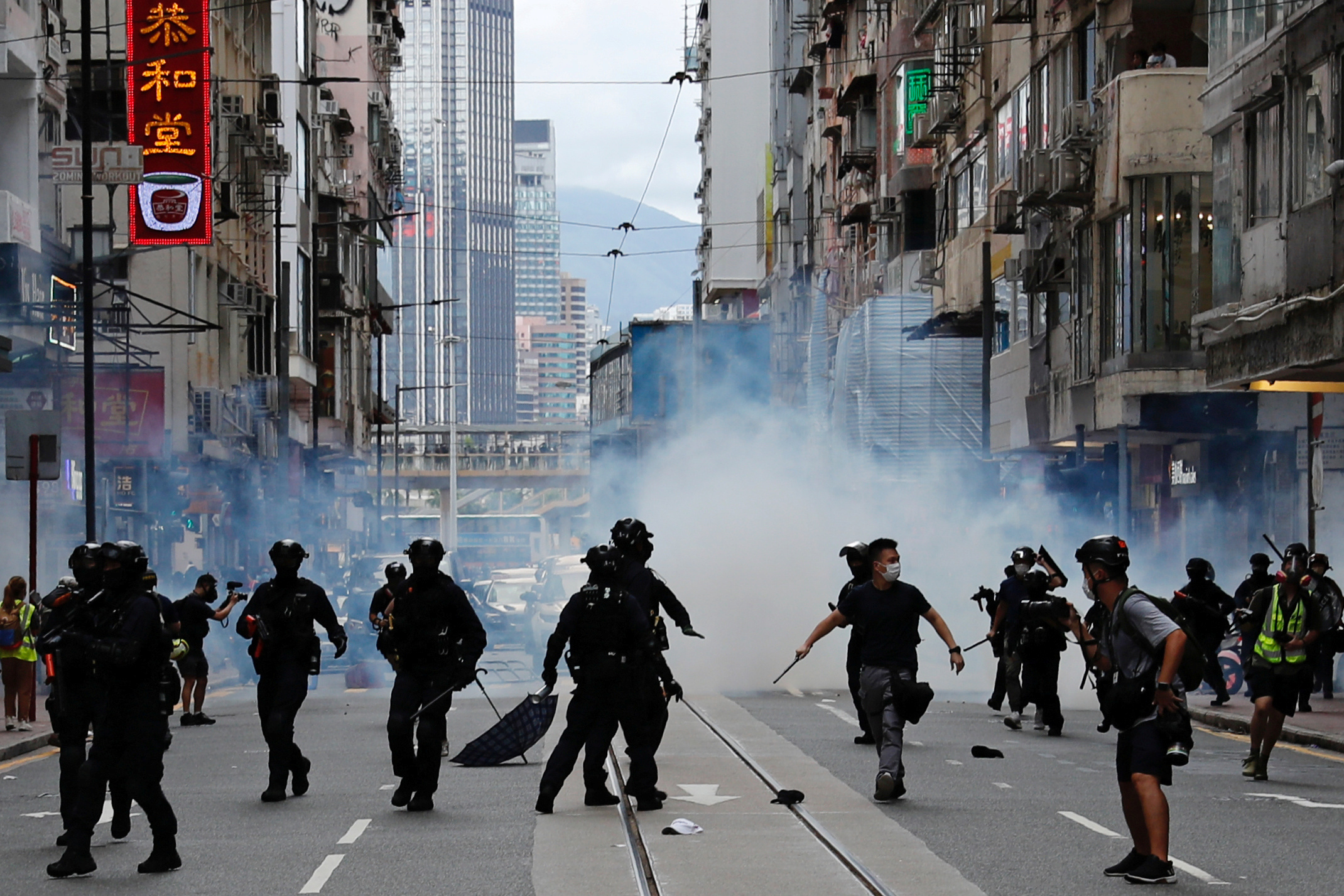 Riot police fire tear gas into the crowds to disperse anti-national security law protesters during a march at the anniversary of Hong Kong's handover to China from Britain in Hong Kong, China July 1, 2020.
