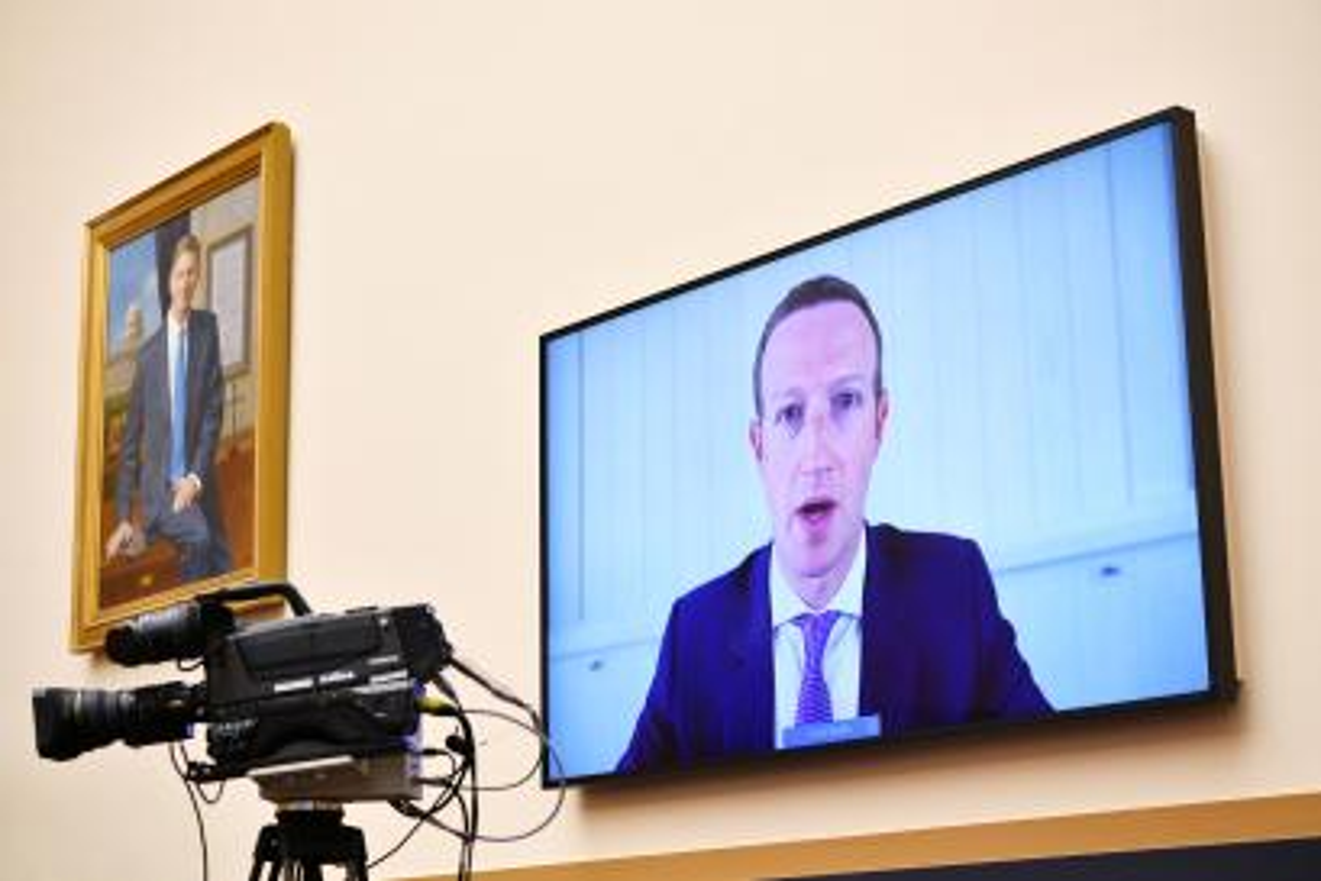 Mark Zuckerberg testifying over video.