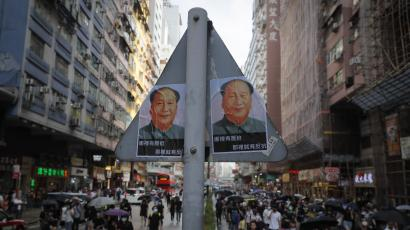 Hong Kong protest, featuring Mao posters.