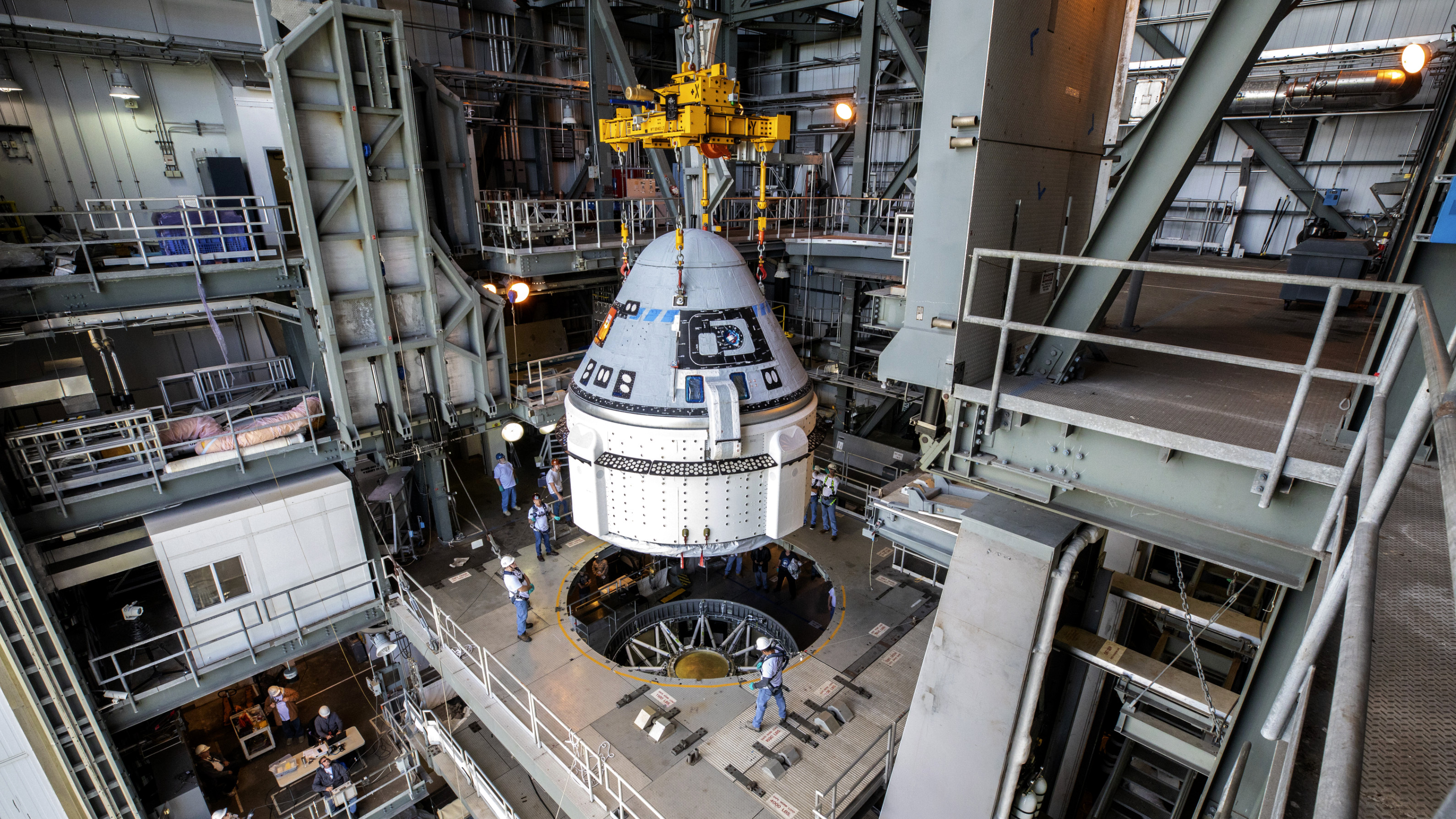 Boeing's Starliner is attached to an Atlas V rocket before a 2019 test flight.