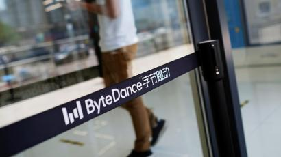 Man walks by a logo of Bytedance, which owns short video app TikTok, at its office in Beijing
