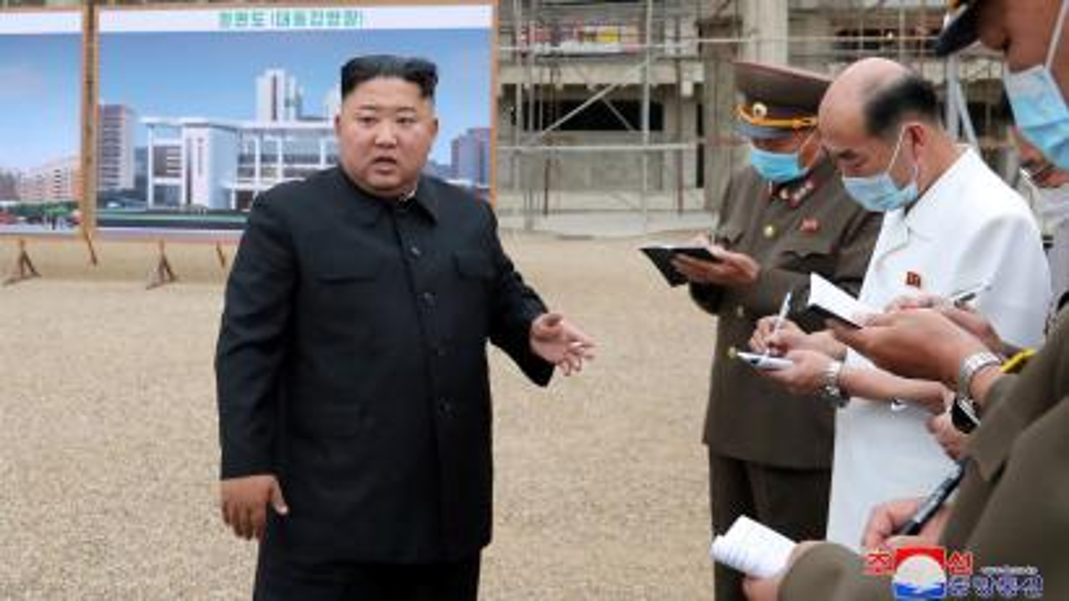 North Korean leader Kim Jong Un speaks at a hospital under construction