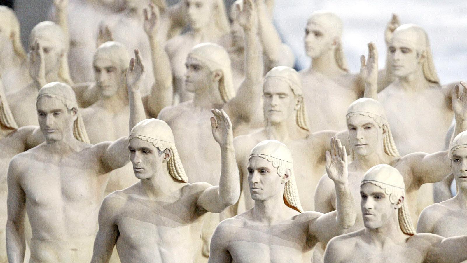 men dressed up as greek statues