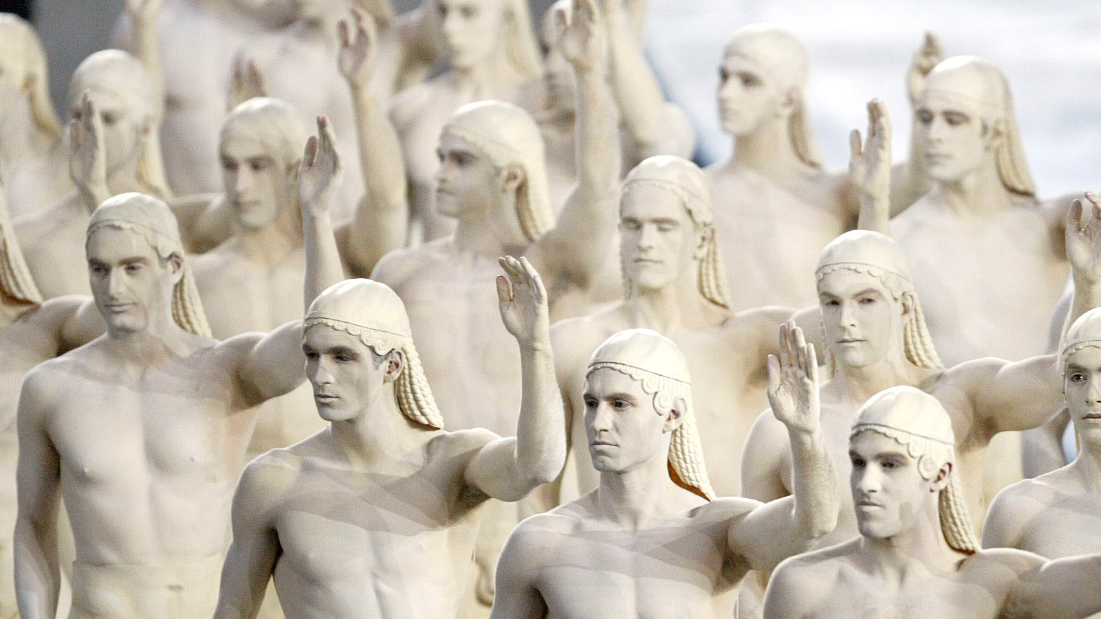 men dressed up as greek statues