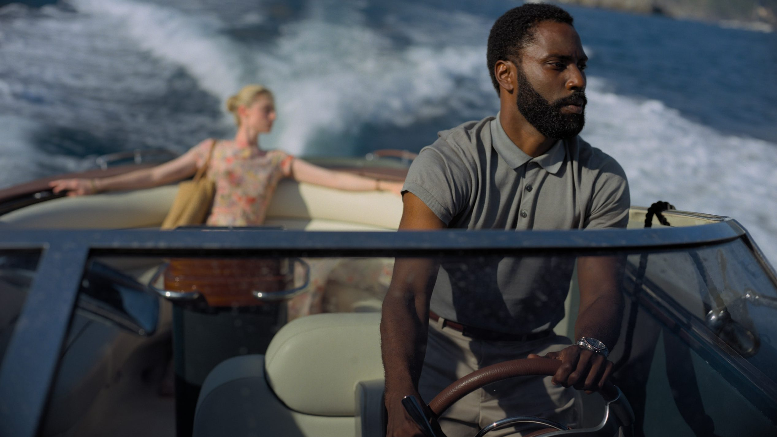 photo of actors in a boat from the film tenet