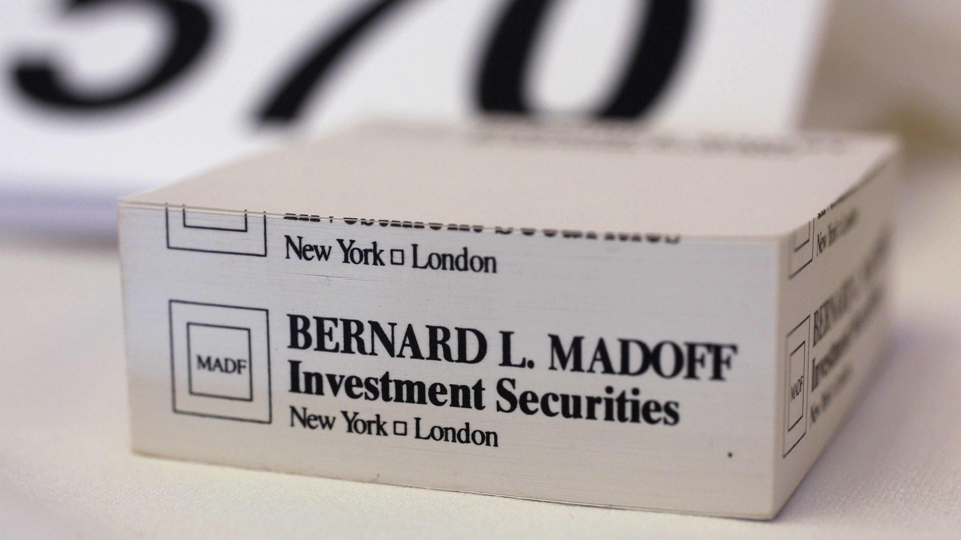 """A """"stickies"""" pad embossed with the investment firm of convicted Ponzi schemer Bernard Madoff is auctioned in Florida in 2011."""