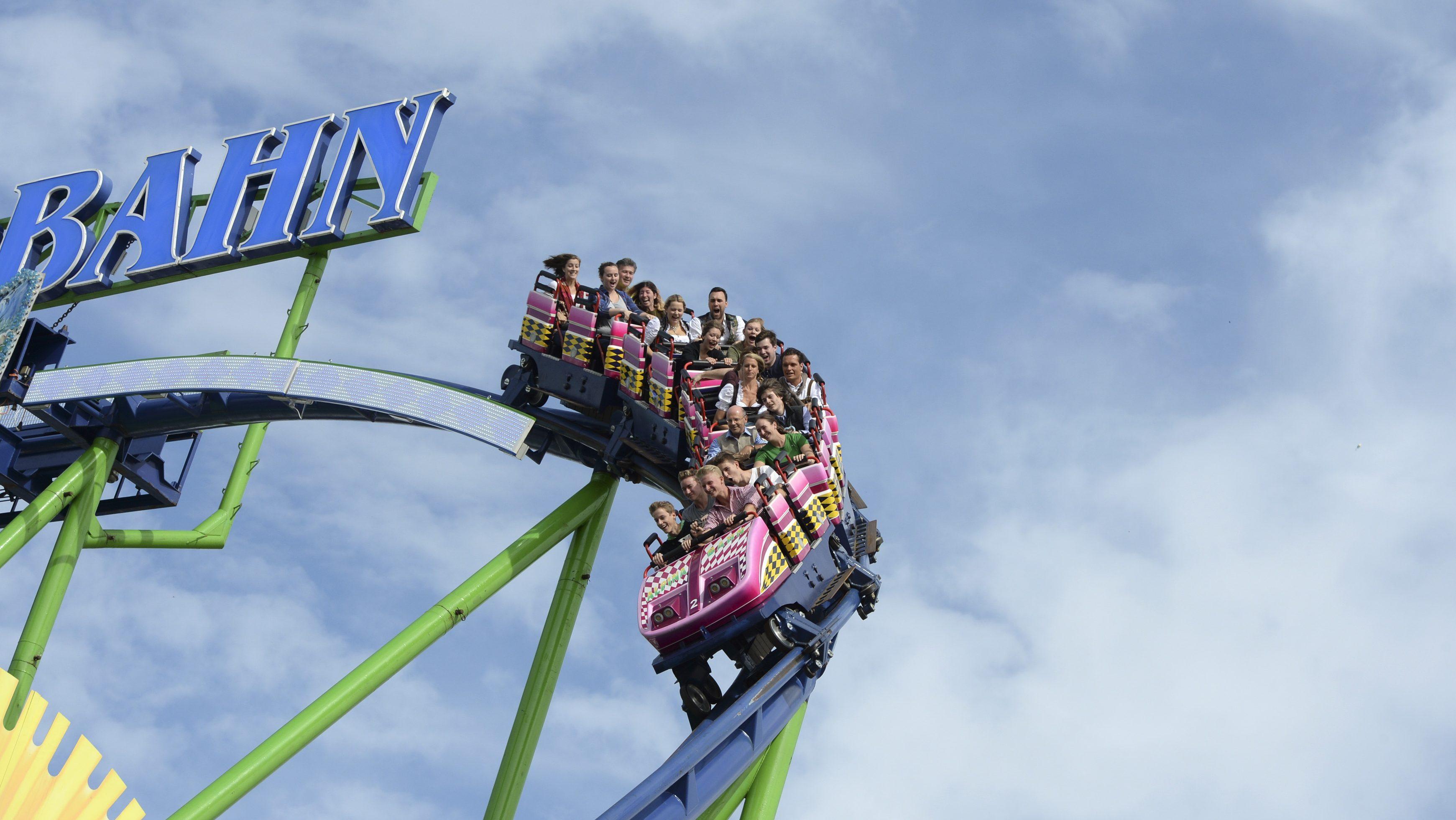 Visitors enjoy a rollercoaster ride in Munich.