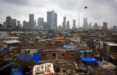 Mumbai slums contrasted against the city's business district