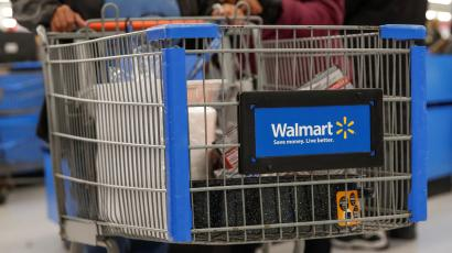 A customer pushes a shopping cart at a Walmart store