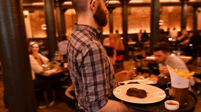 """Staff work at Hawksmoor, Seven Dials on the opening day of """"Eat Out to Help Out"""" scheme."""