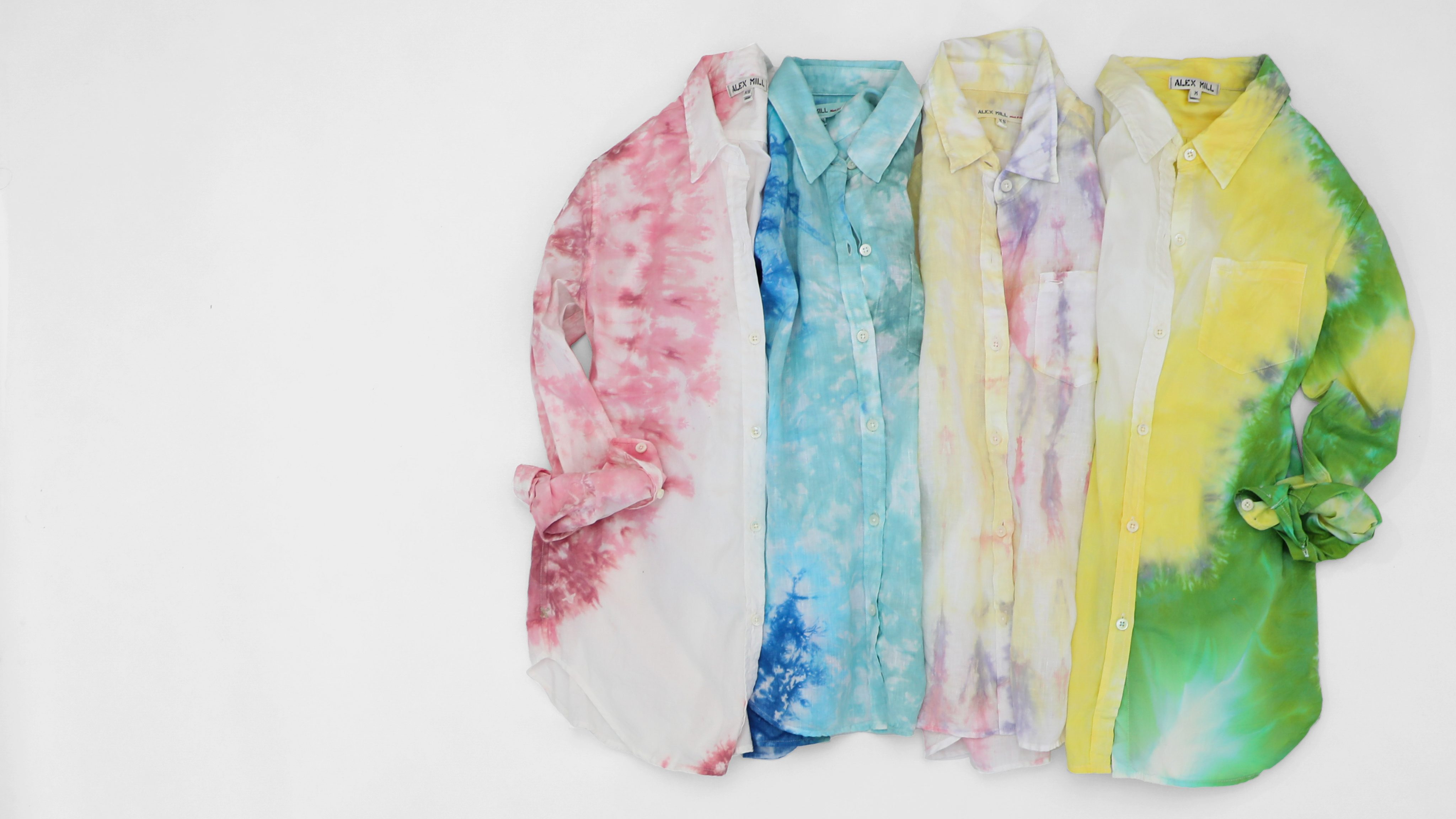 Alex Mill tie-dyed button-down shirts in bright pastel colors.