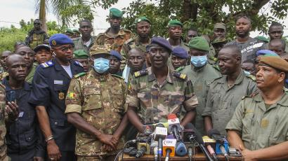 Colonel-Major Ismael Wague, centre, spokesman for the soldiers identifying themselves as National Committee for the Salvation of the People, speaks during a press conference at Camp Soudiata in Kati, Mali, Wednesday, Aug. 19, 2020.