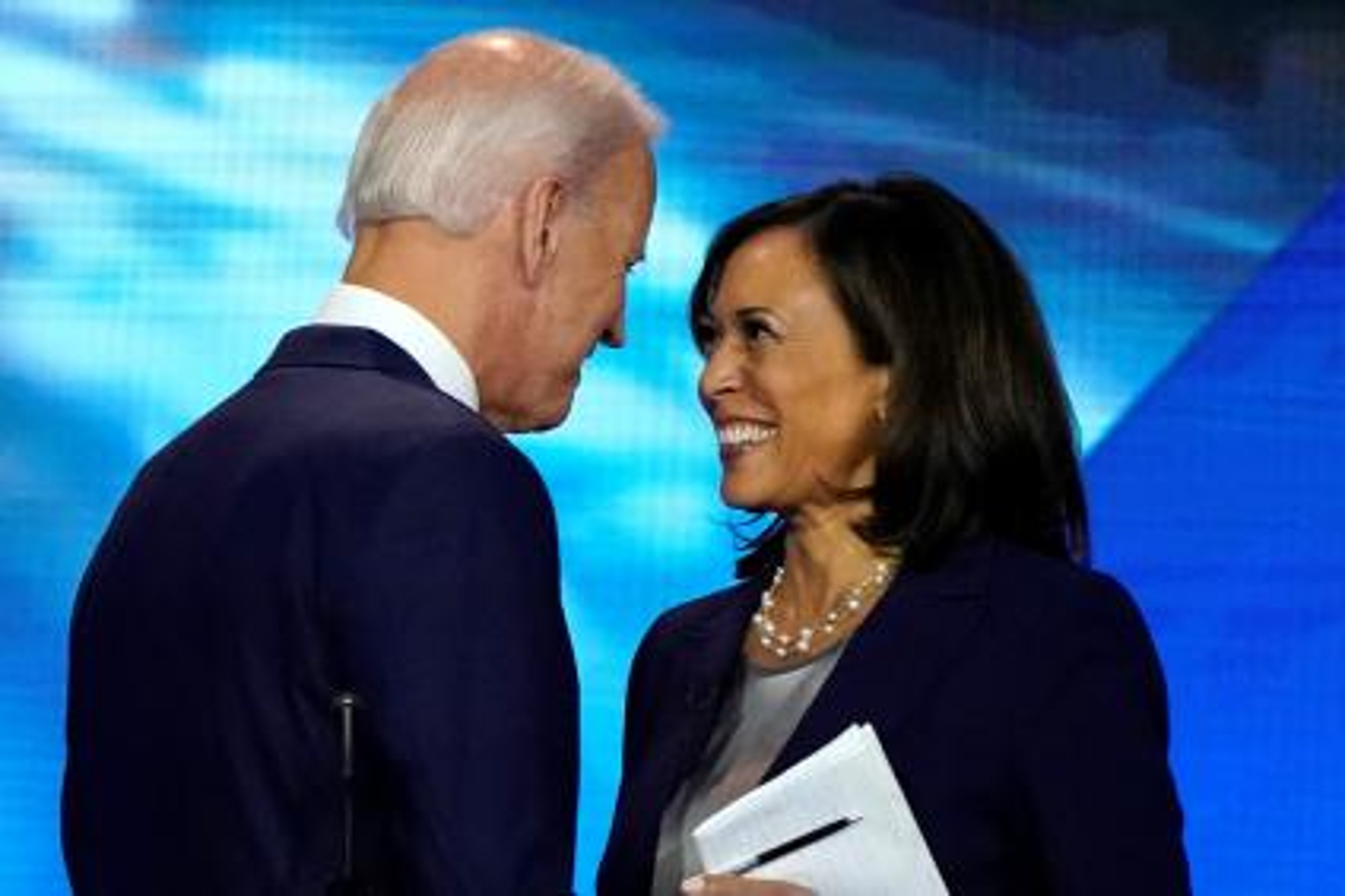 Former Vice President Joe Biden talks with Senator Kamala Harris after the conclusion of the 2020 Democratic U.S. presidential debate in Houston, Texas, U.S., September 12, 2019.
