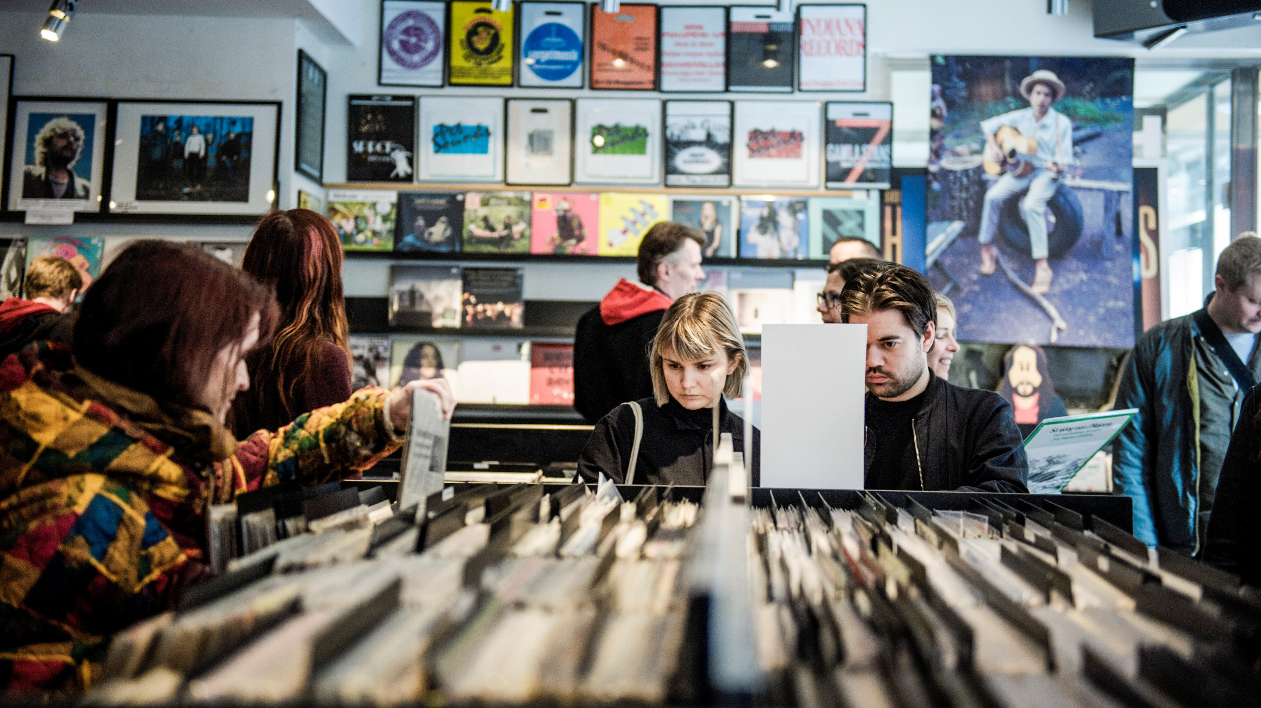 Customers sift through albums in a record store during the international Record Store Day in Stockholm