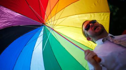 man with rainbow umbrella