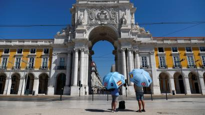 Tourist guides wait for customers at Comercio square, amid the Covid-19 outbreak, in Lisbon, Portugal