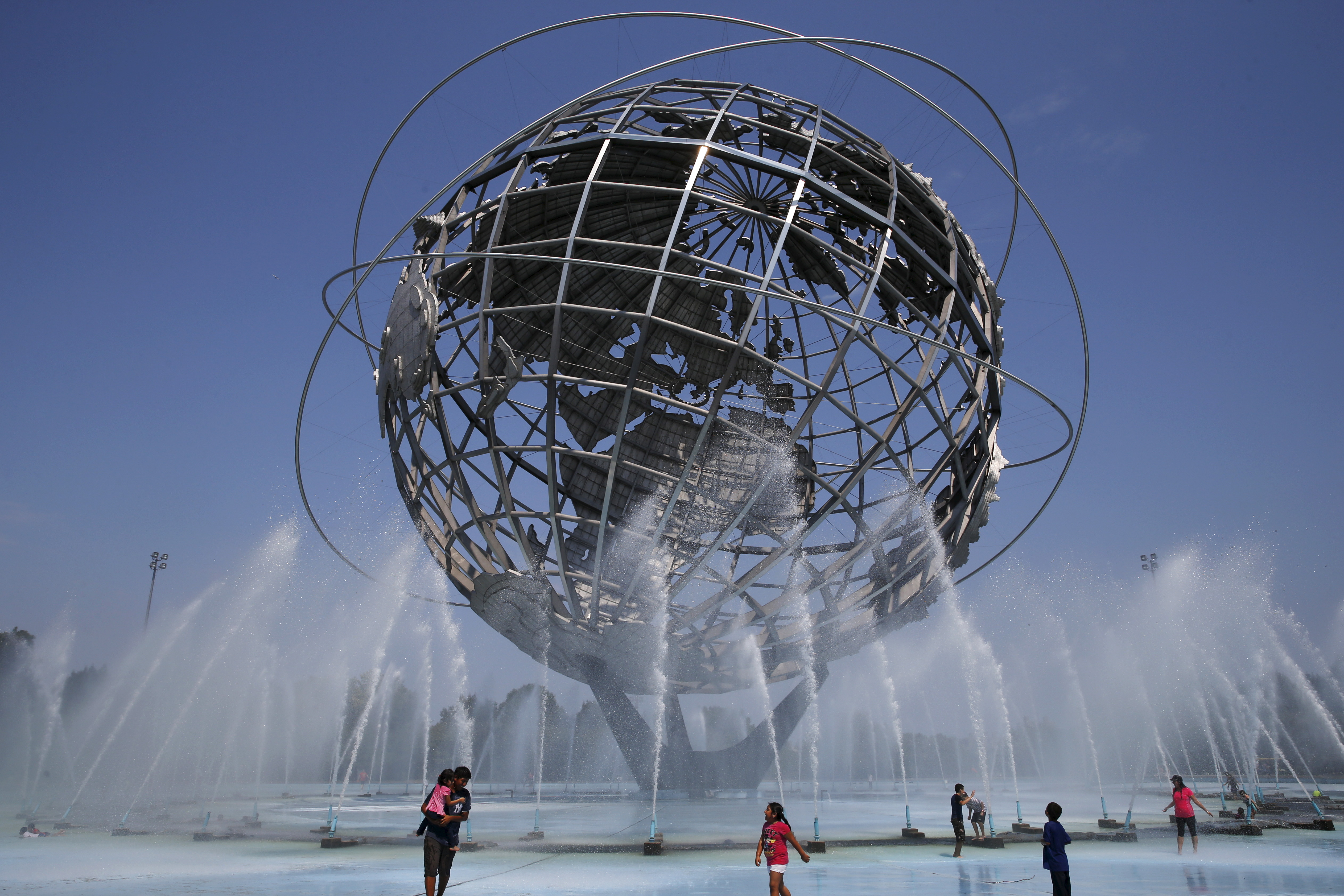 People cool off in the water at the Unisphere at Flushing Meadows Corona Park in the Queens borough of New York in 2015.