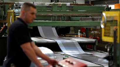A worker at perforating company Bion uses a machine at the factory in Reading, UK.