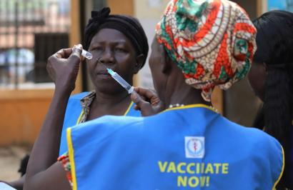 South Sudanese health workers prepare to administer vaccination. Global vacconation rates have fallen because of Covid-19.