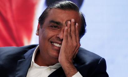 Mukesh Ambani, chairman and managing firector of Reliance Industries, gestures as he answers a question during a media interaction in New Delhi, India, June 15, 2017.