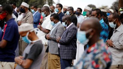 Family members and friends of Abdullahi Adan, 52, who died due to coronavirus, pray before his funeral in Nairobi.