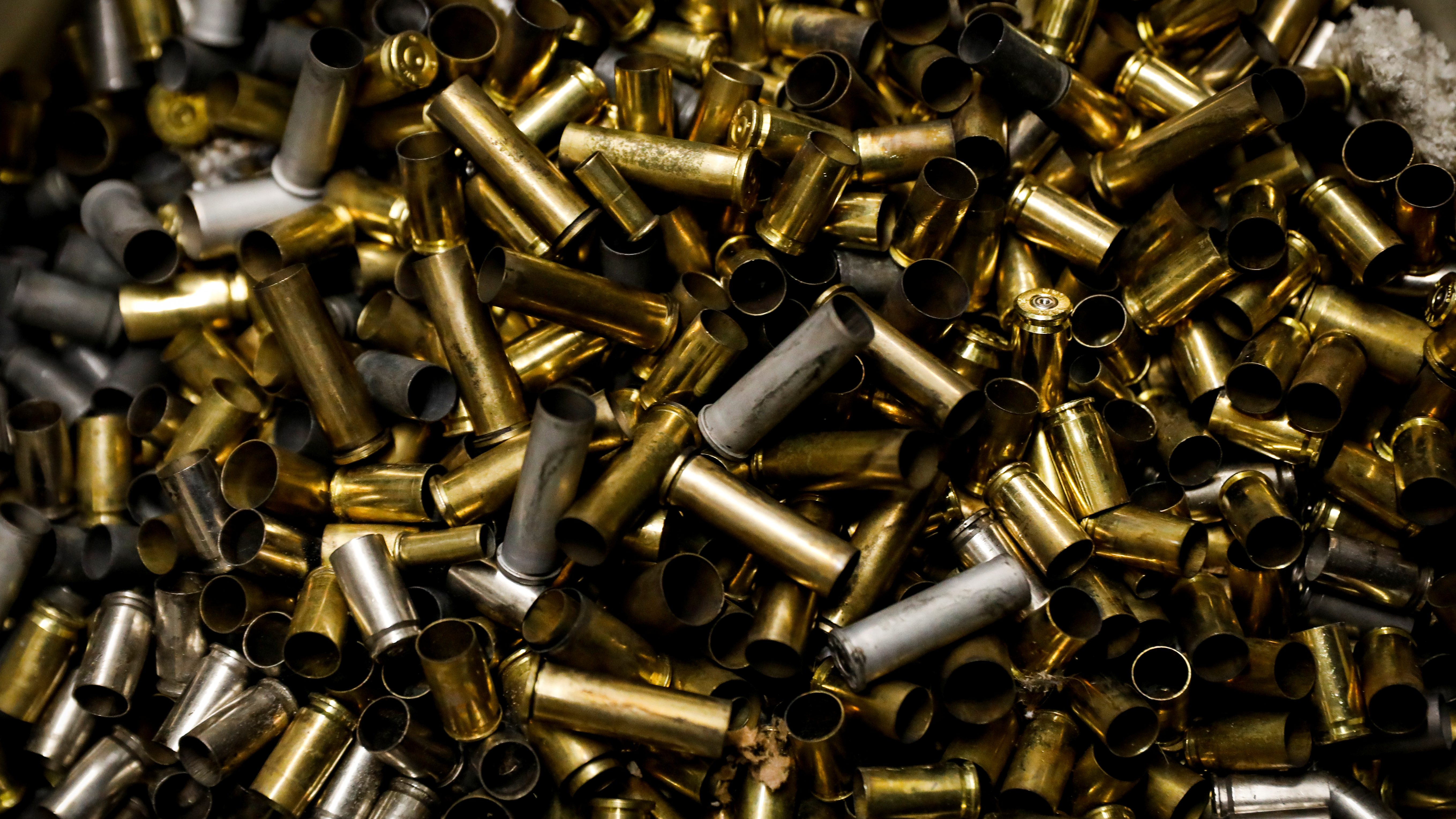 Discarded bullet shell cases are seen at Master Class Shooting Range in Monroe, New York, USA