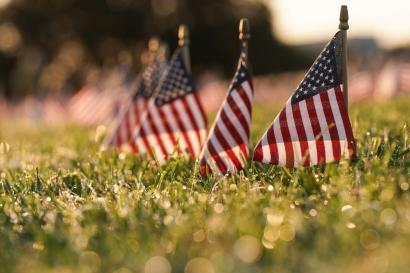 American flags representing 200,000 lives lost due to coronavirus pandemic are placed on National Mall in Washington