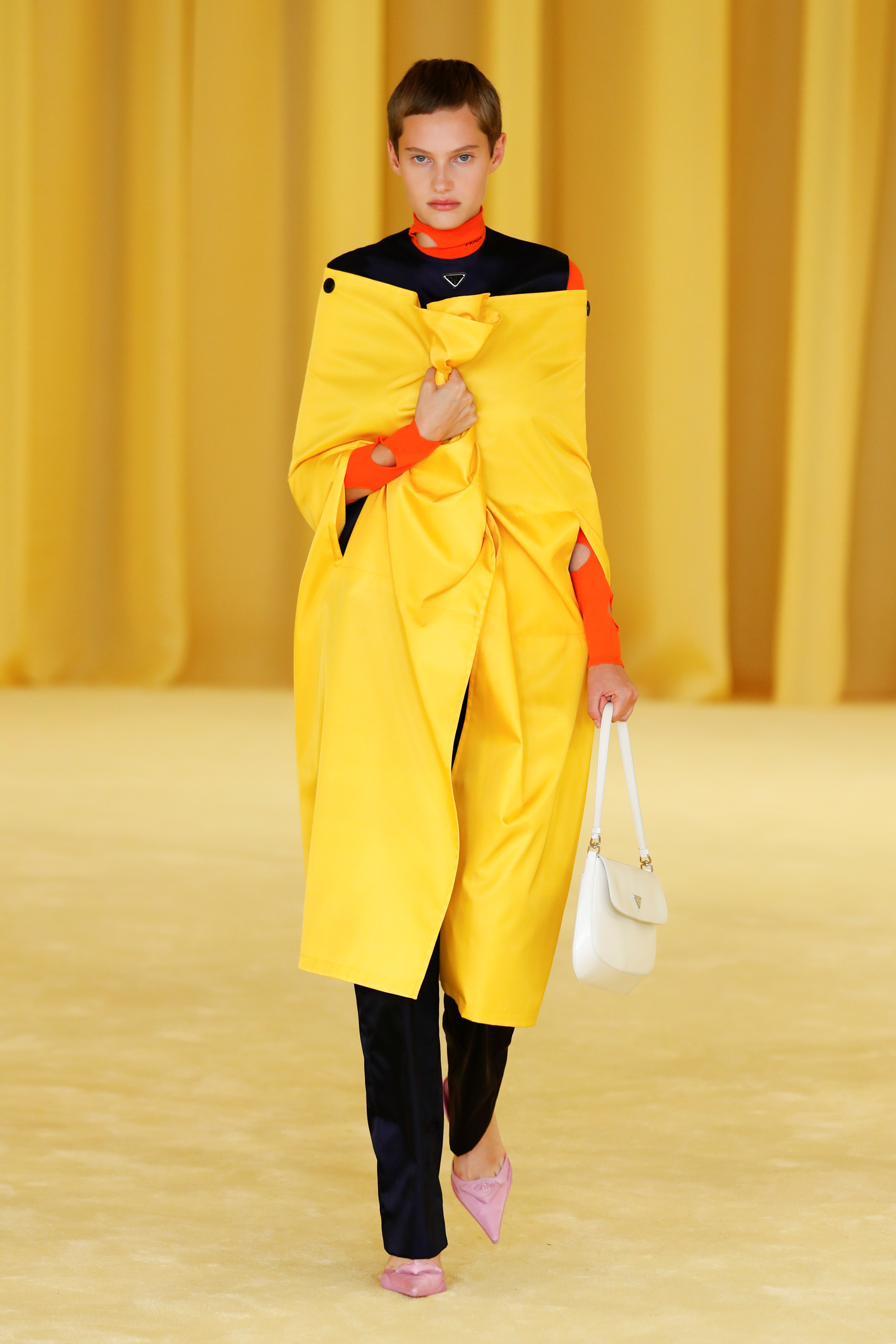 A model presents a creation from the Prada Spring/Summer 2021 women's collection during fashion week in Milan, Italy, in this handout photo released on September 24, 2020.