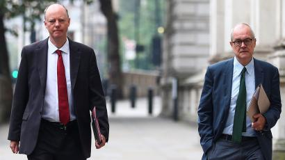 Chief Medical Officer for England Chris Whitty and Chief Scientific Adviser Sir Patrick Vallanc walk in London;