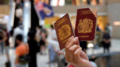 A pro-democracy demonstrator holds up a pair of British National Overseas (BNO) passports