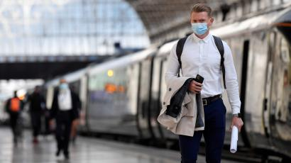 Commuters wearing face masks arrive at Paddington Station following the outbreak of the coronavirus disease (COVID-19) in London, Britain June 15, 2020.