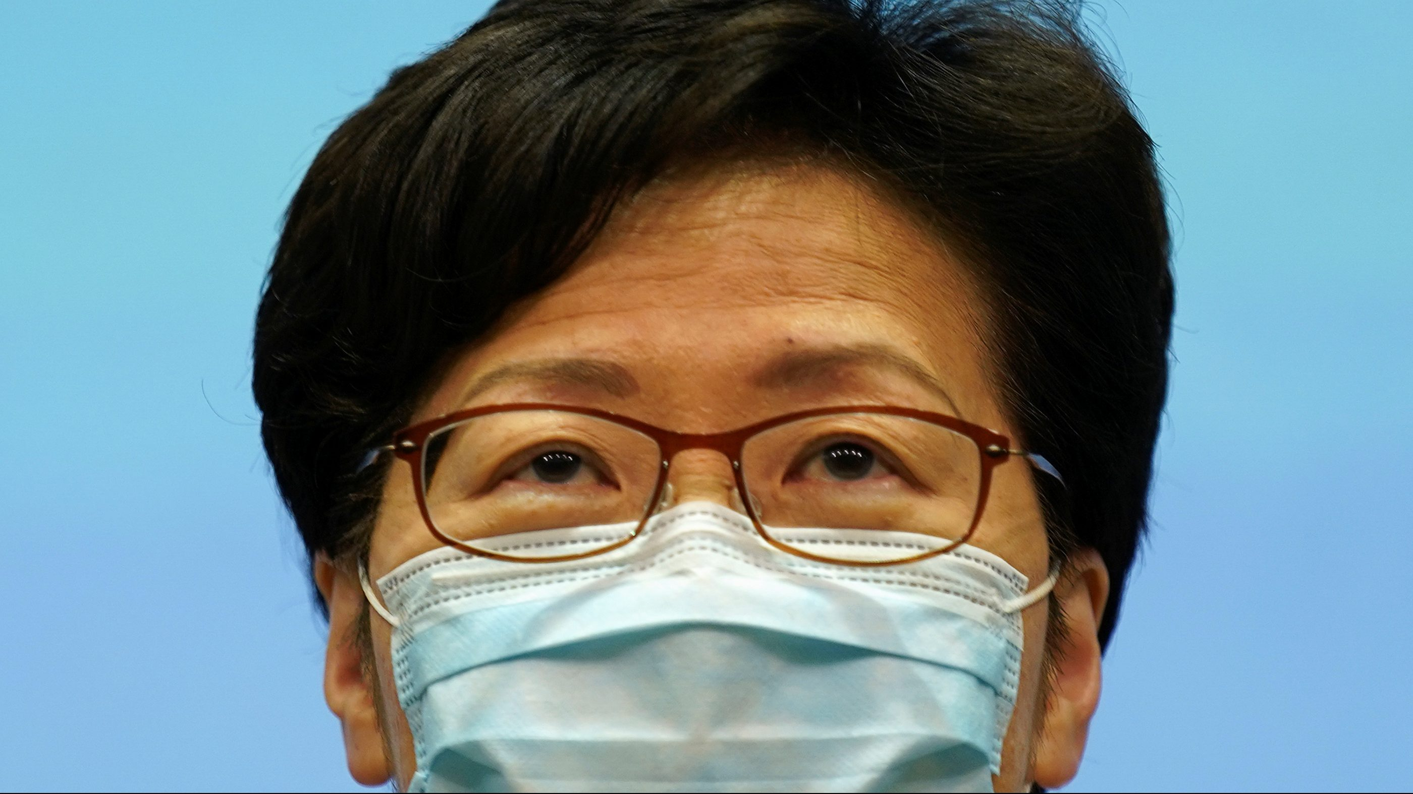 Hong Kong's chief executive Carrie Lam wears a mask at a press conference
