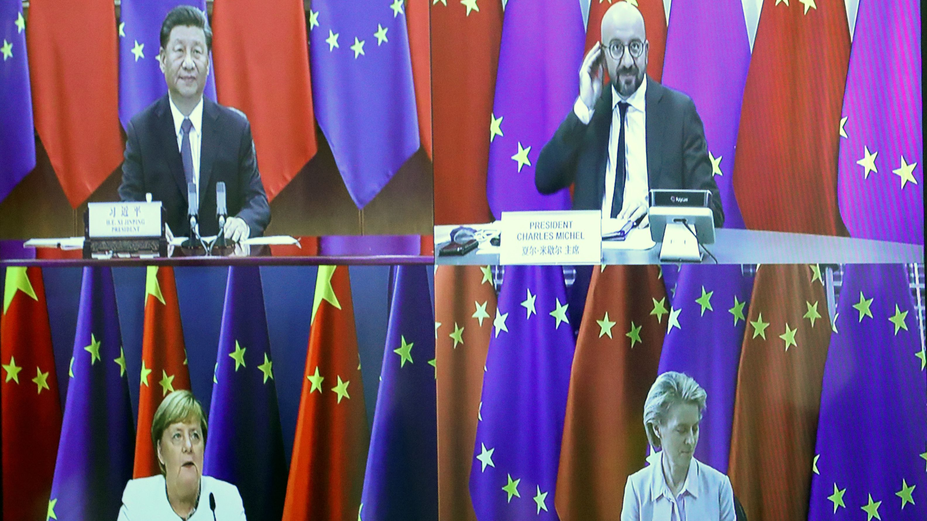 A screen shows XI Jinping, Charles Michel, Ursula Von der Leyen, and Angela Merkel.