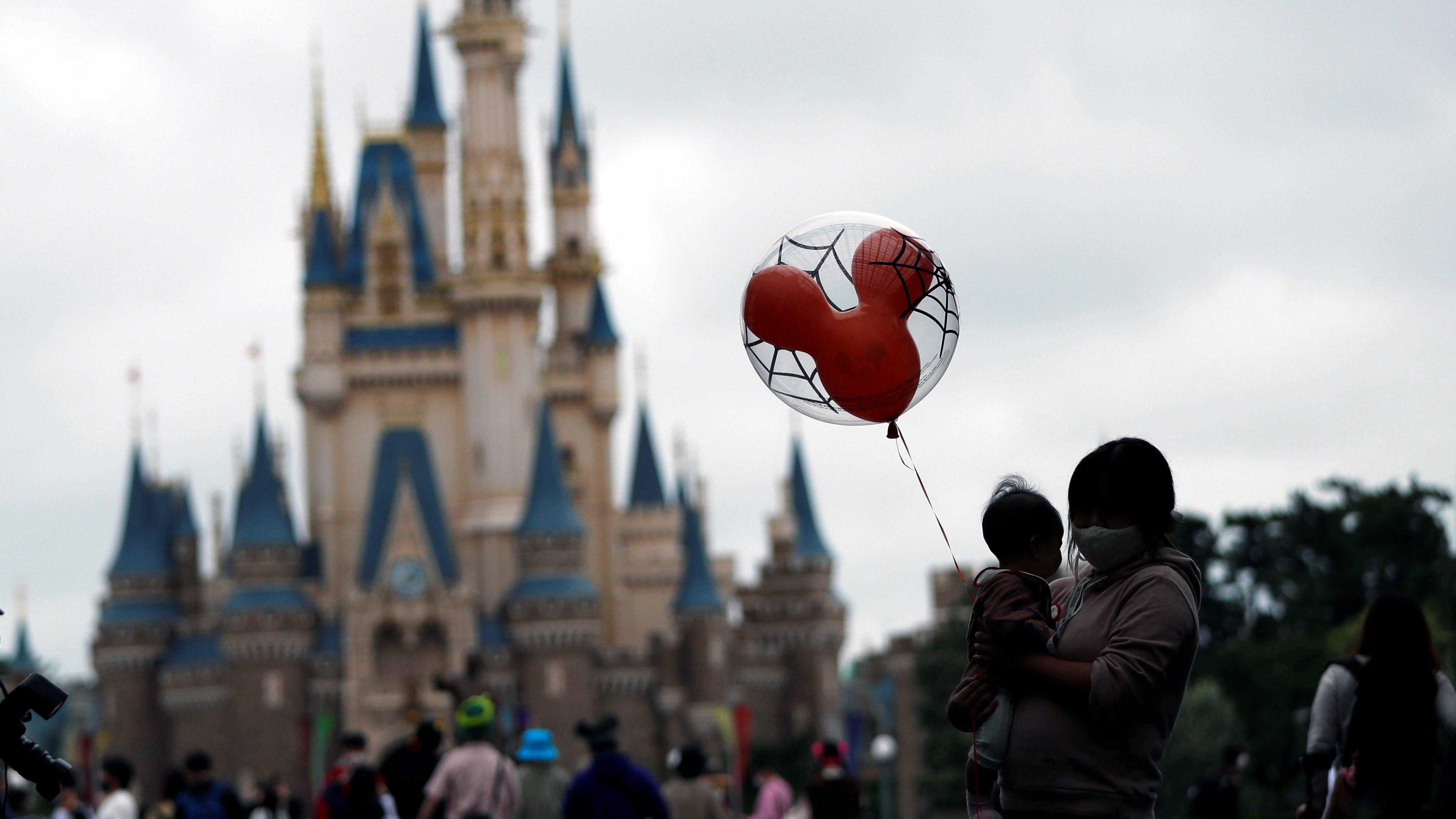 Visitors are seen, amid the coronavirus disease (COVID-19) outbreak, at Tokyo Disneyland in Urayasu
