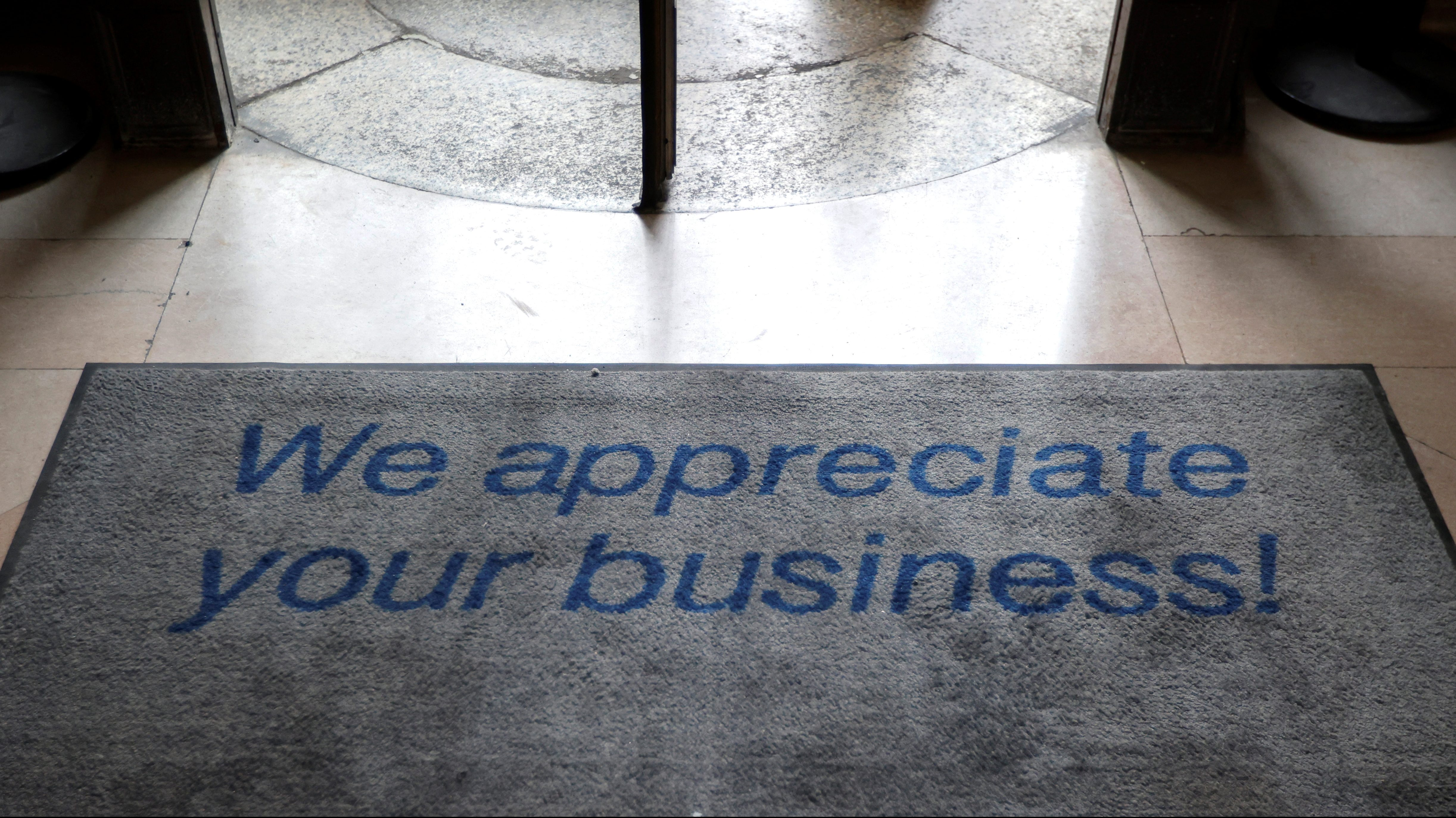 "A floor mat says ""We appreciate your business!"""