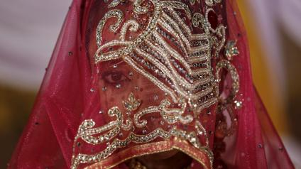 A Muslim bride waits for the start of a mass marriage ceremony in Mumbai, India, January 27, 2016. A total of 12 Muslim couples took their wedding vows during the mass marriage ceremony organised by a Muslim voluntary organisation, organisers said.