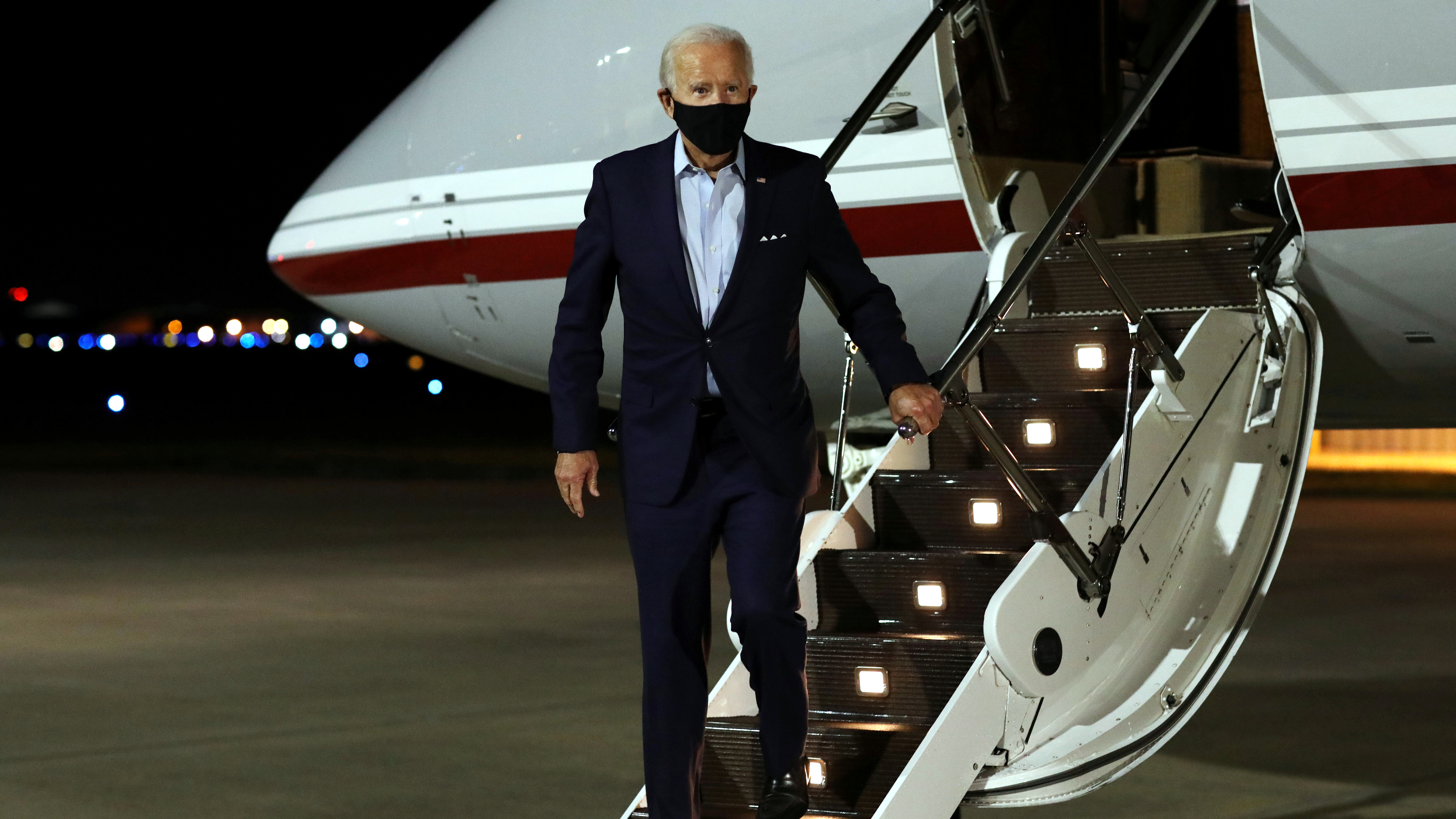 Democratic U.S. presidential nominee Joe Biden disembarks his plane after arriving at New Castle Airport in New Castle