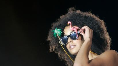 model with an afro wearing sunglasses