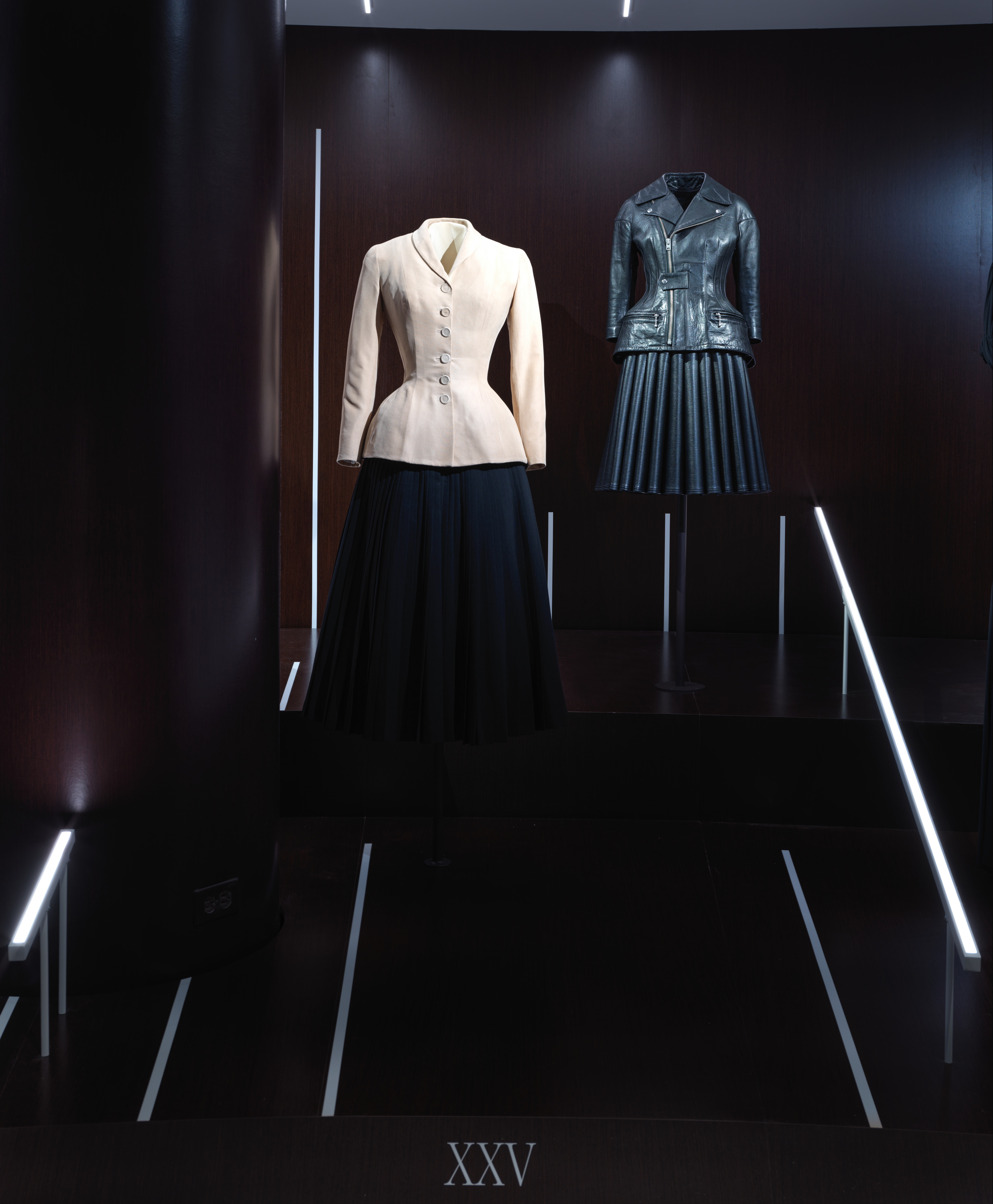 "Left: ""Bar"" Suit, Christian Dior, spring/summer 1947; right, leather jacket and skirt, Junya Watanabe, fall/winter 2011"