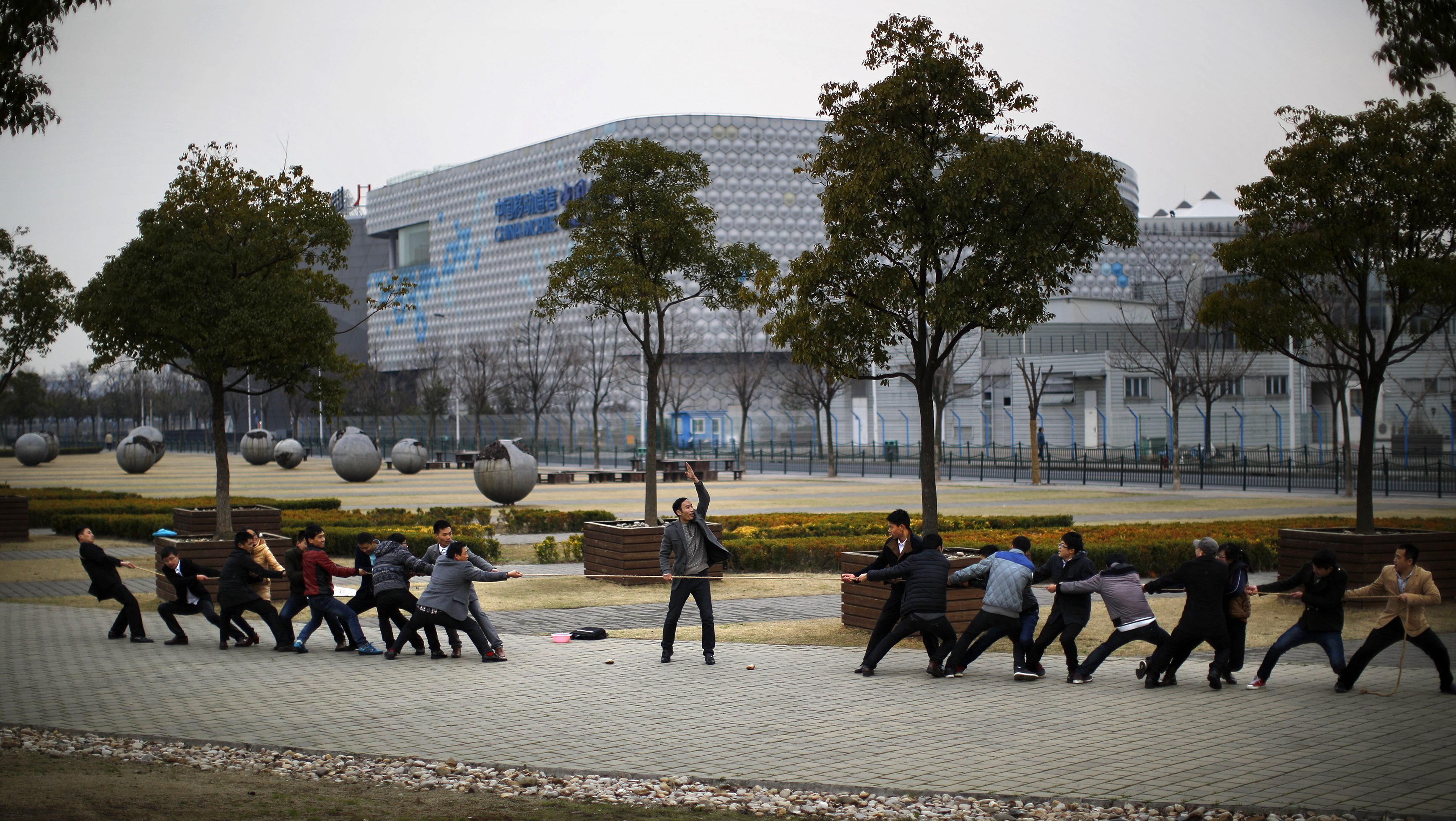 Local residents play tug-of-war as they pull a rope at a park in Shanghai March 2, 2014.