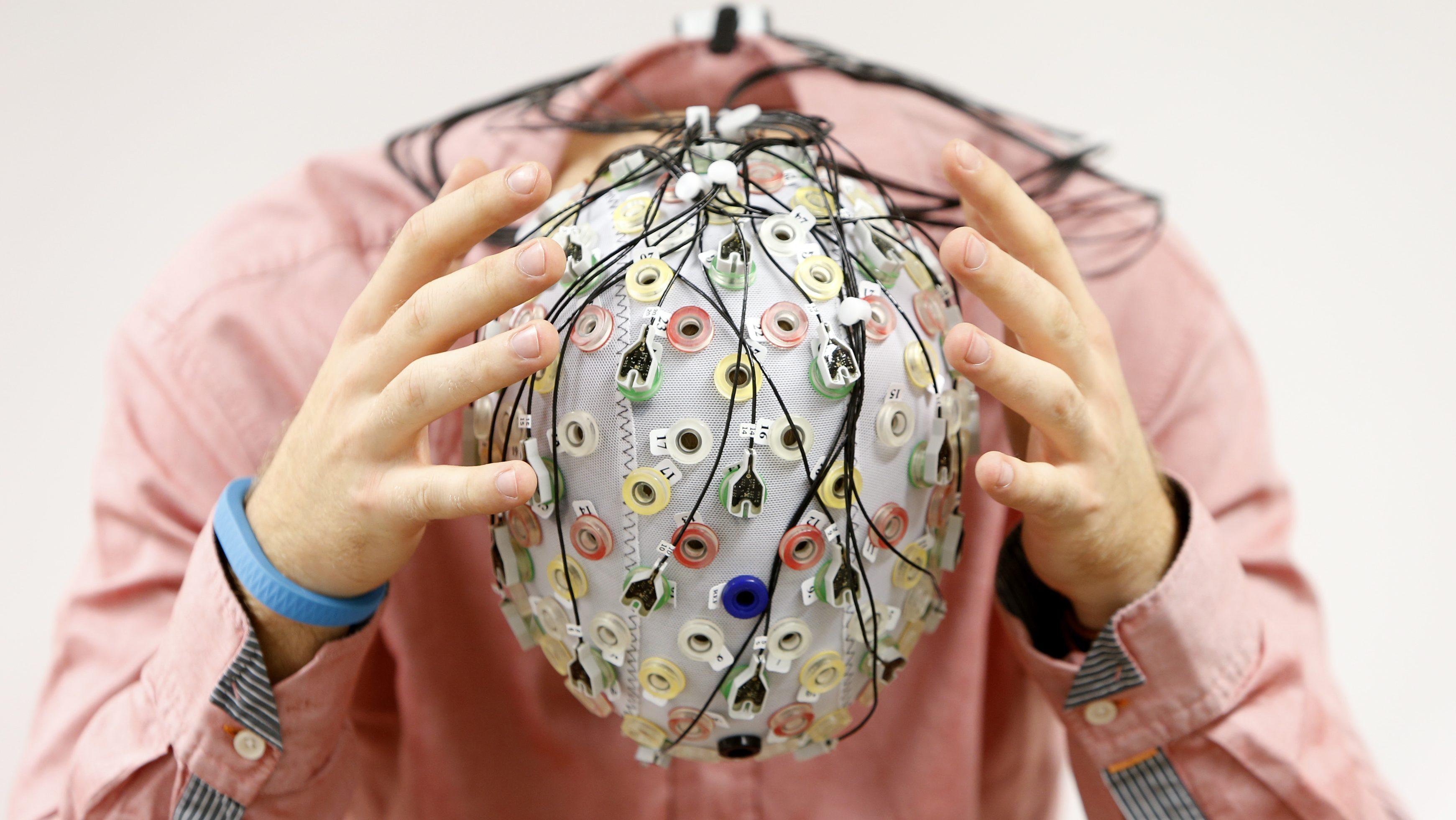Test subject in an electroencephalography (EEG) cap