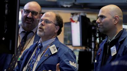 Specialist traders from Citadel LLC and KCG Holdings Inc. work inside a post on the floor of the New York Stock Exchange (NYSE)
