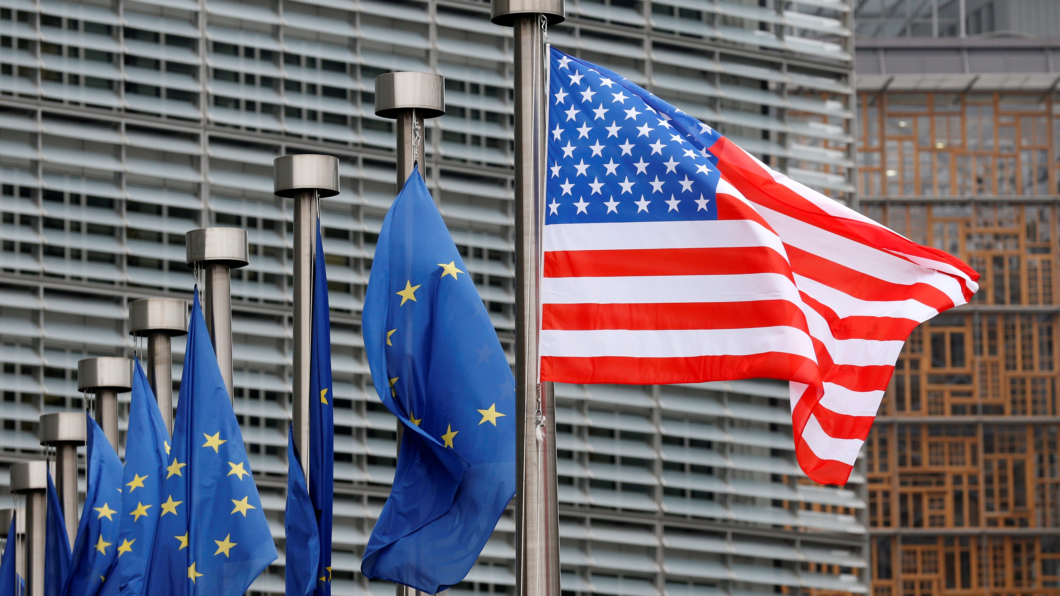 US and European Union flags at the European Commission headquarters in Brussels.