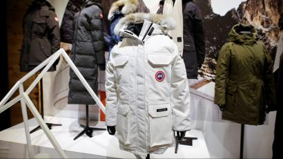 Jackets hang in the showroom of the Canada Goose factory in Toronto, Ontario